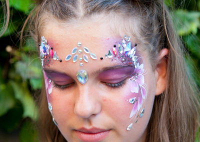 Face painting and gems